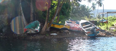 Fishing boats lining the shore in Dominica