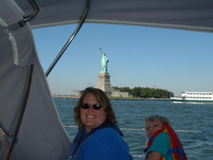 Lorrie and Gregg II in front of the Statue of Liberty