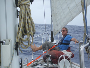 Gregg resting on sail bag on passage