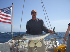 Gregg Granger holding a 4 foot Wahoo